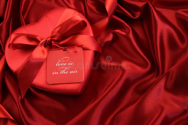 Chocolate box with gift card on satin stock photography
