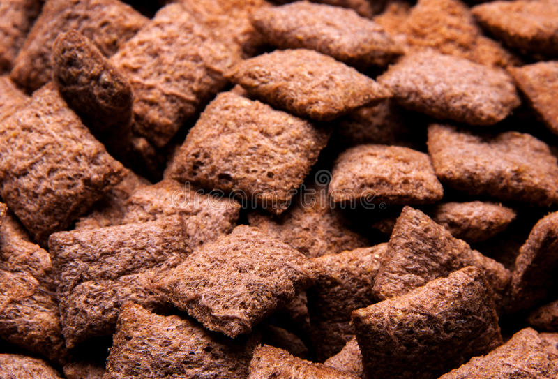 Chocolate breakfast cereal texture. Cereal balls as background. Chocolate corn balls wallpaper background cover stock image