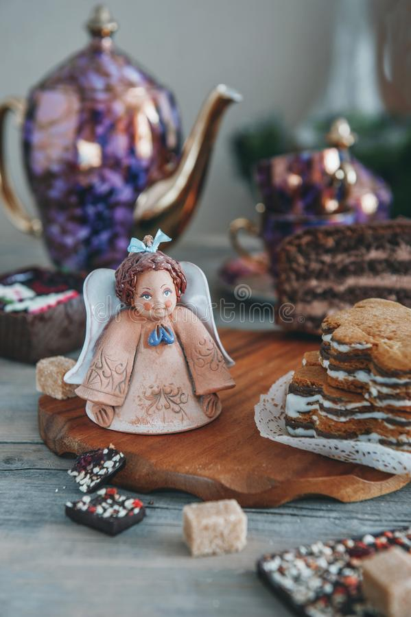 Chocolate brown cupcake with walnuts, cinnamon and honey on the Christmas table.  stock photography