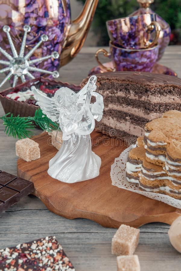 Chocolate brown cupcake with walnuts, cinnamon and honey on the Christmas table.  royalty free stock image