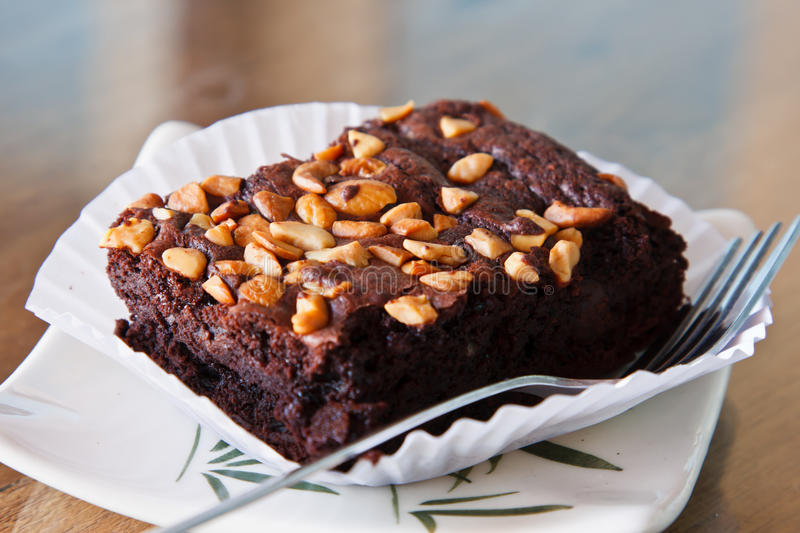Chocolate brownie cake with almond. On table royalty free stock images