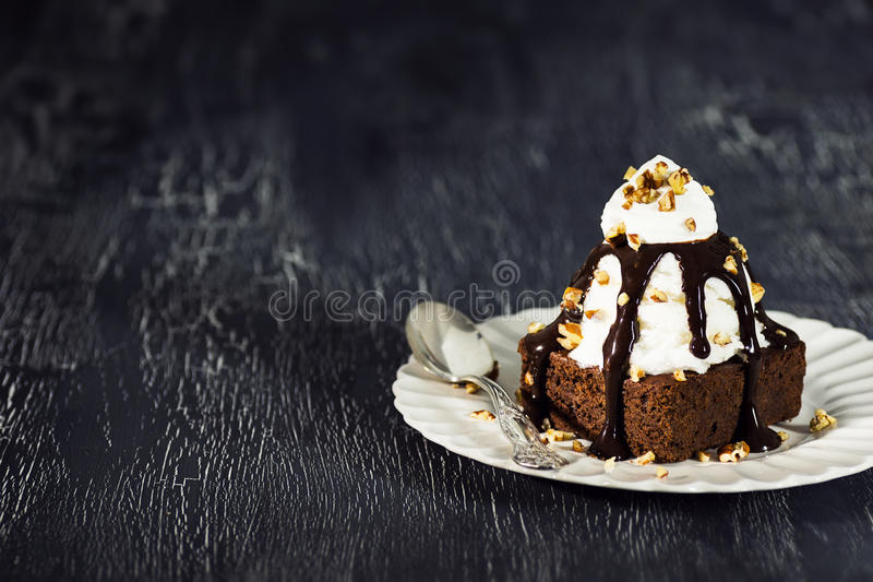 Chocolate Brownie Sundae with Whipped Cream royalty free stock images