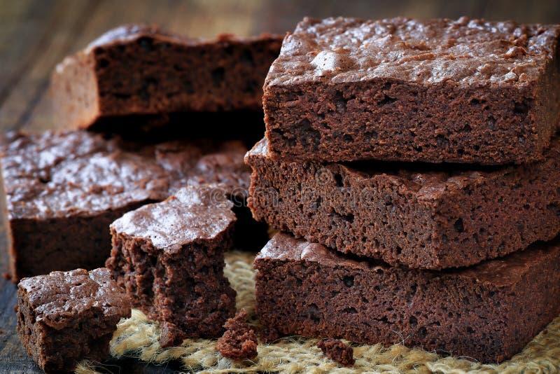 Chocolate brownies. Stack of homemade chocolate brownies bars closeup stock photo
