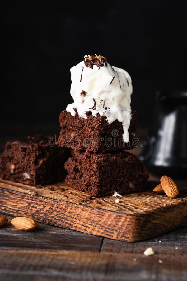Chocolate brownies with vanilla ice cream stock images