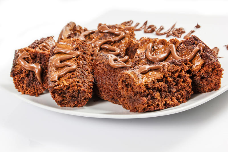 Chocolate brownies on white plate stock photography