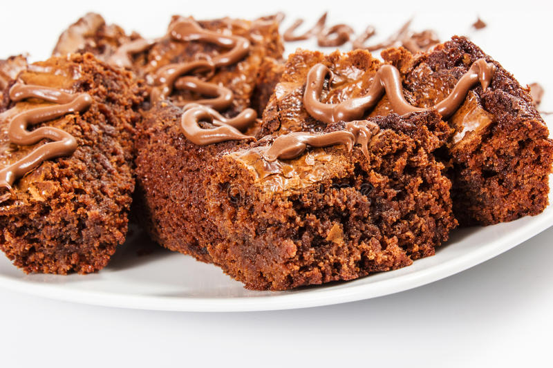 Chocolate brownies on white plate royalty free stock photography