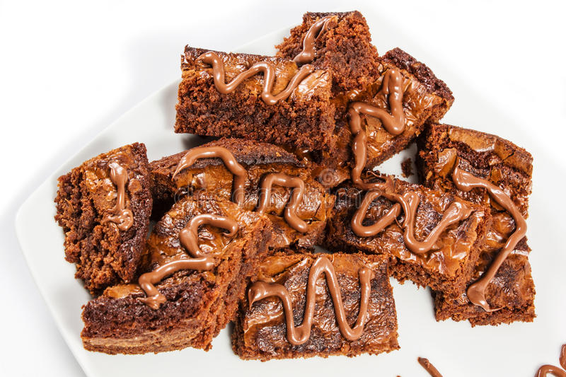 Chocolate brownies on white plate royalty free stock photo