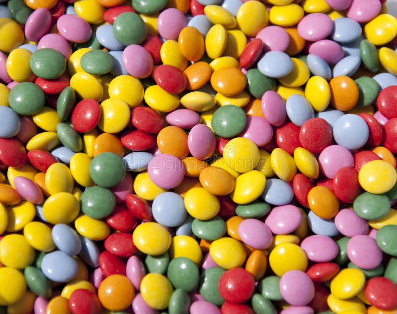 Chocolate buttons candy. Colorful smarties chocolate candy buttons background royalty free stock photography