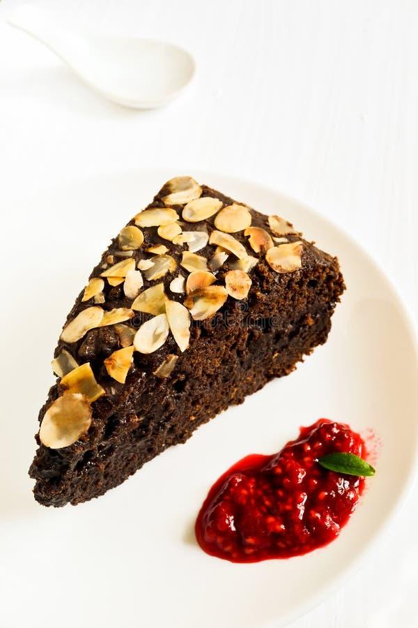 Chocolate cake with almonds and raspberry stock photos