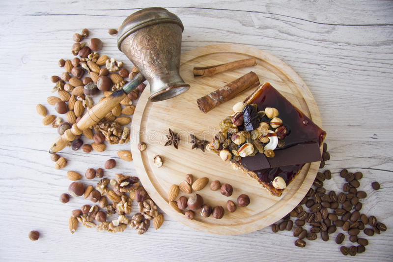 Chocolate cake. With almonds and walnuts stock photos