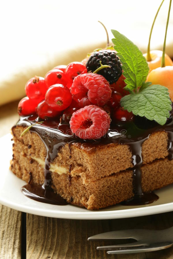 Chocolate cake with berries (raspberry, currant, cherry) royalty free stock photos