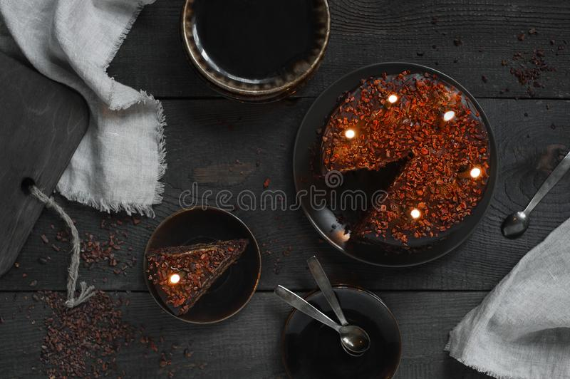 Chocolate cake with birthday candles on the wooden table royalty free stock photos