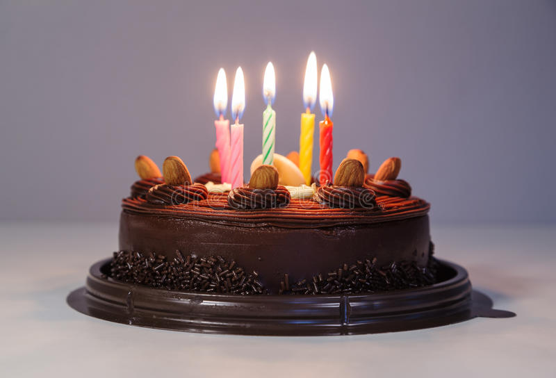 Chocolate cake with birthday light candle. Chocolate cake with happy birthday light candle stock image