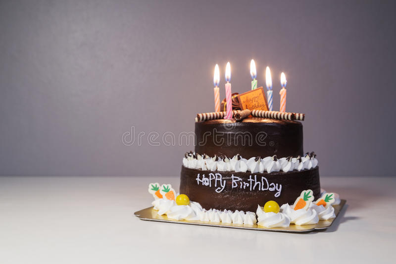 Chocolate cake with birthday light candle. Chocolate cake with happy birthday light candle royalty free stock images