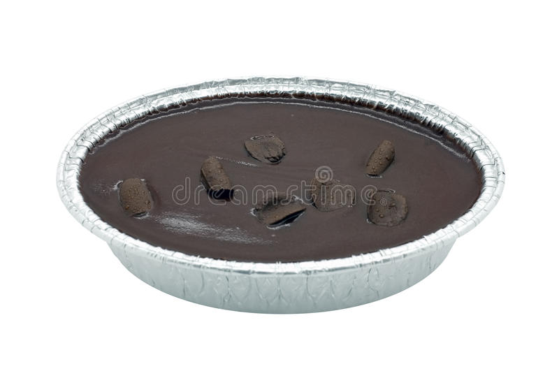 Chocolate cake in box isolated on white background. Chocolate cake in foil oval box isolated on white background royalty free stock photo