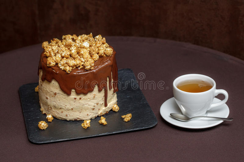Chocolate cake with caramel and popcorn, close up. Chocolate cake with caramel and popcorn, closeup stock photography
