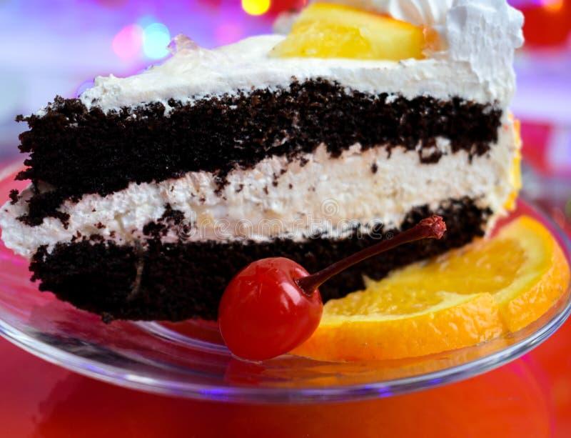 Chocolate cake cherry dessert slice. Pie bakery piece sweet cream food brown white plate delicious gourmet red sugar tasty bright holiday orange royalty free stock image