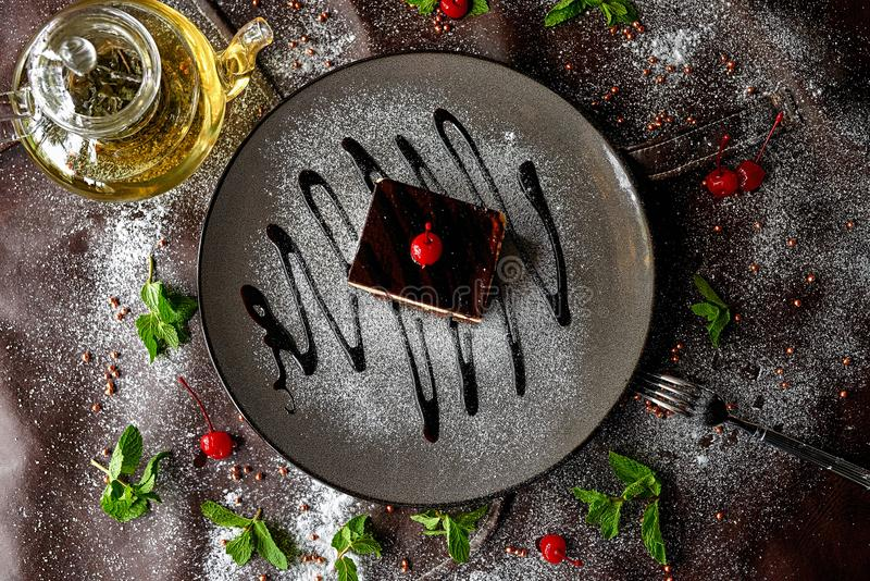 Chocolate cake in powdered sugar royalty free stock photo