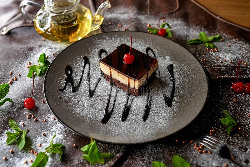 Chocolate cake in powdered sugar royalty free stock photography