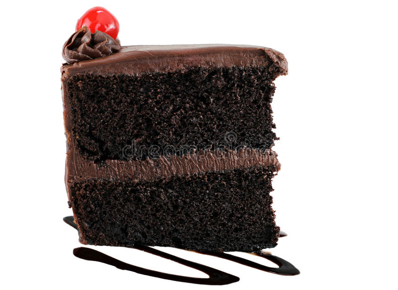 Chocolate cake with chocolate icing and a cherry. stock photo