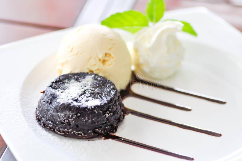 Chocolate cake or chocolate lava cake with ice cream stock photo