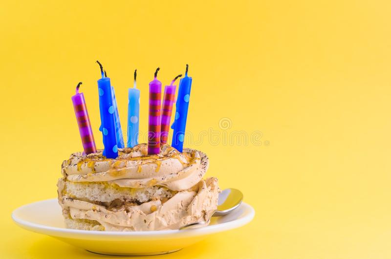 Chocolate Cake With Cream And Lots Of Candles On A Yellow Background