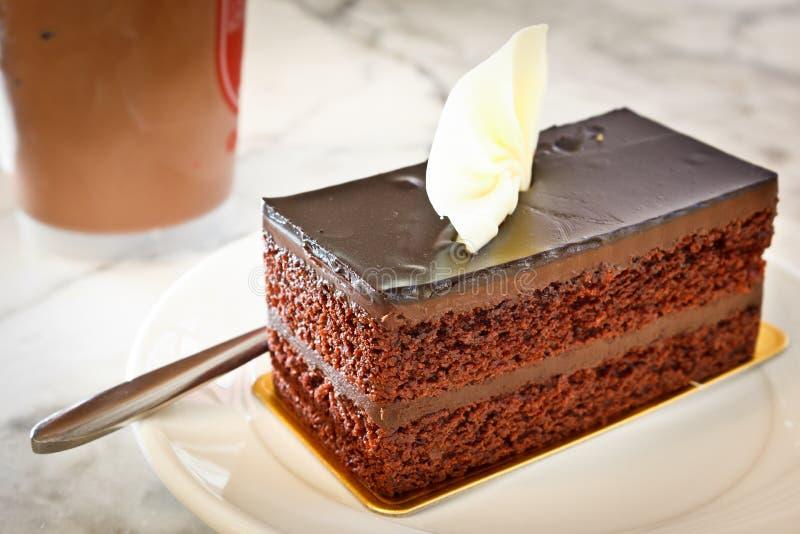 Chocolate cake. Dark chocolate cake for coffee break stock photo