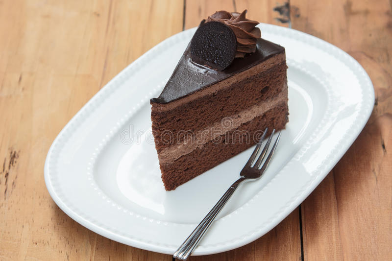 Chocolate cake. Delicious chocolate cake on a white plate stock image