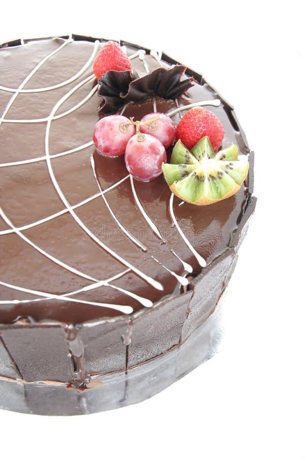 Chocolate cake with fruit garnish stock images