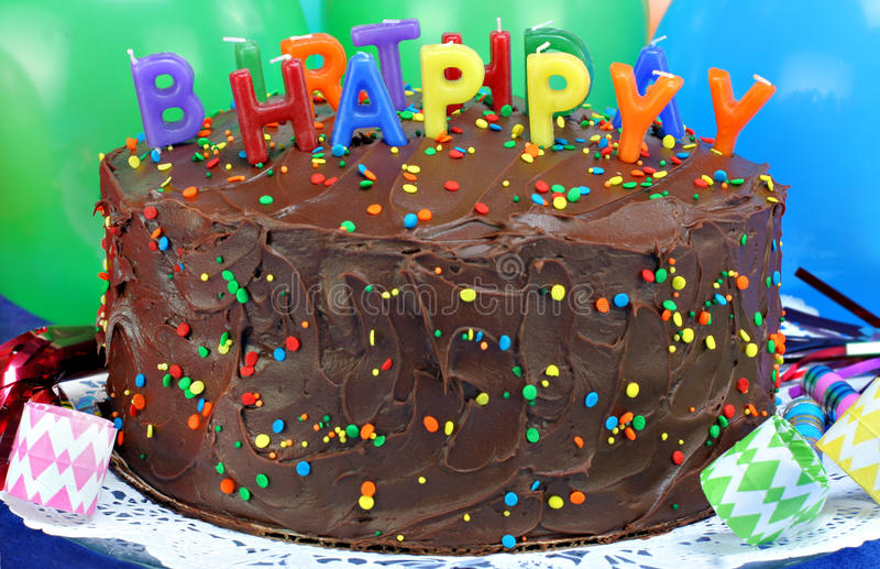 Chocolate cake & Happy Birthday candles. stock photo
