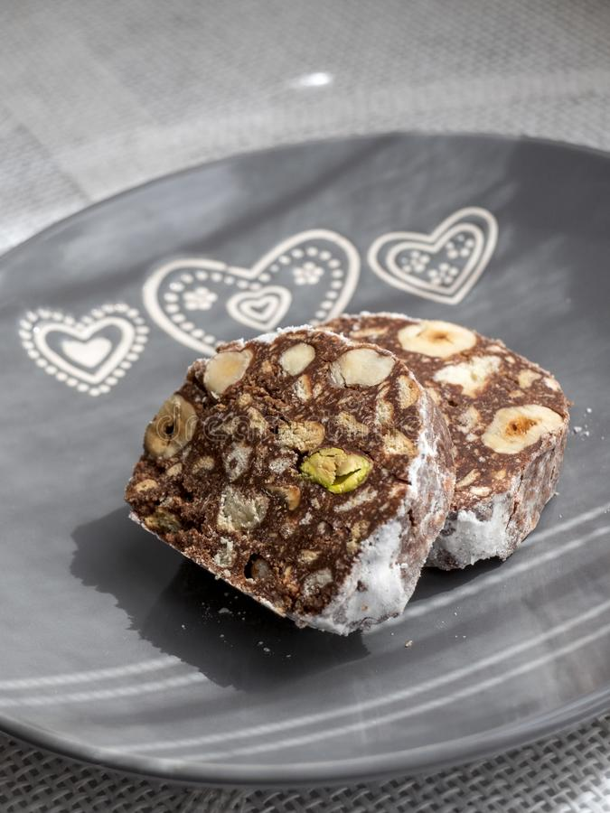 Chocolate cake with hazelnuts and pistachios. royalty free stock image