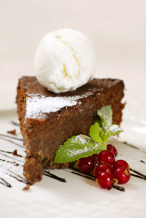 Chocolate cake with icecream. Berries and powdered sugar royalty free stock photography