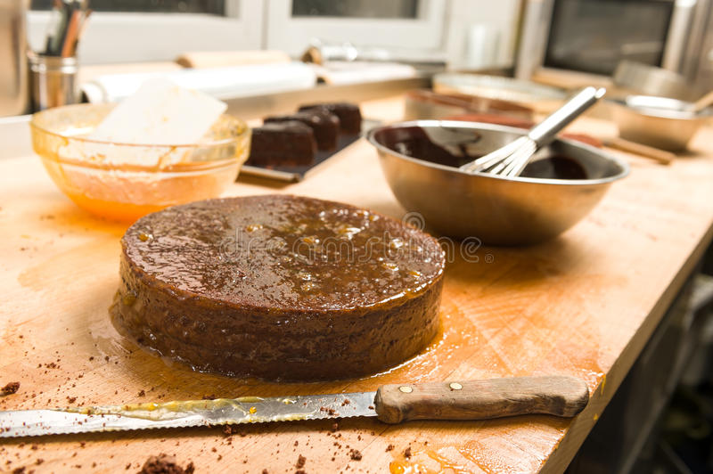 Chocolate cake with jam in the kitchen stock photos