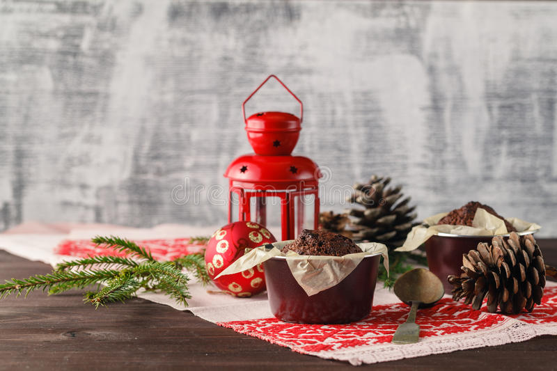 Chocolate cake and little cupcakes with holiday decorations on r royalty free stock photo