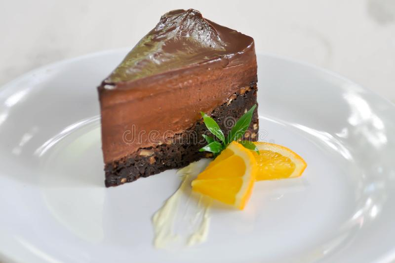 Chocolate cake and orange royalty free stock photography