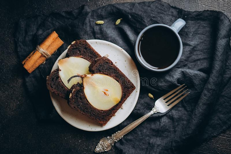 Chocolate cake with pears, cinnamon and cardamom royalty free stock photo