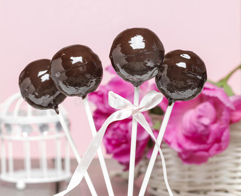 Chocolate cake pops on pink romantic background royalty free stock images
