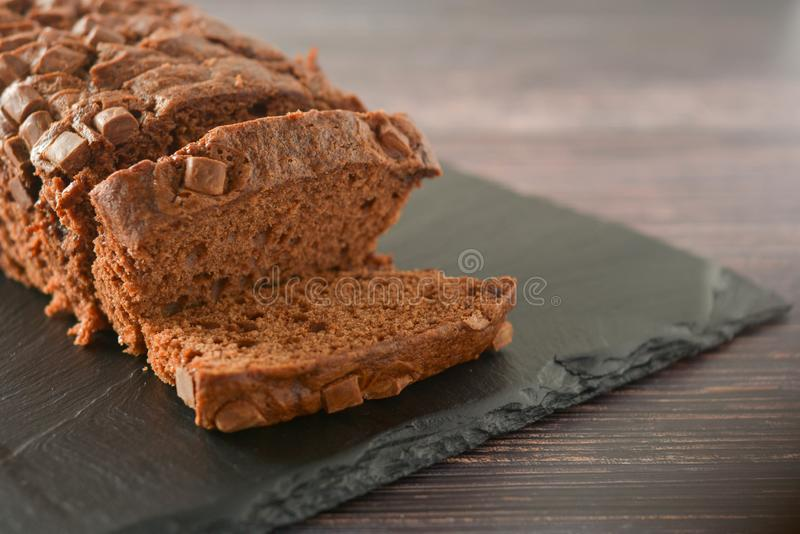 Chocolate cake. Pound cake with chocolate chips, wooden background stock photography