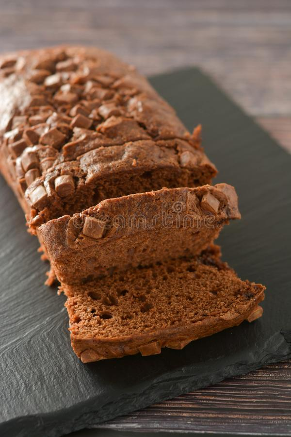 Chocolate cake. Pound cake with chocolate chips, wooden background royalty free stock photo