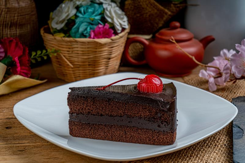 Chocolate cake with red cherry royalty free stock photo