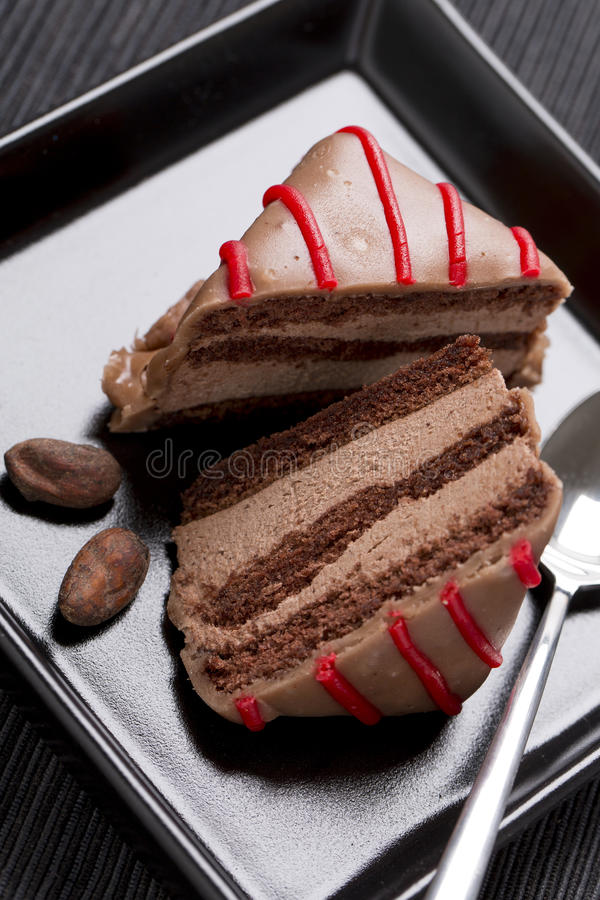 Chocolate cake with red decoration on the plate royalty free stock photography