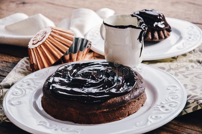 Chocolate cake round-shaped with large portion of glaze. Chocolate cake round-shaped with large portion of chocolate glaze royalty free stock photos