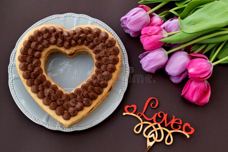 Chocolate cake in shape of heart on Valentine`s Day or Woman`s day royalty free stock image