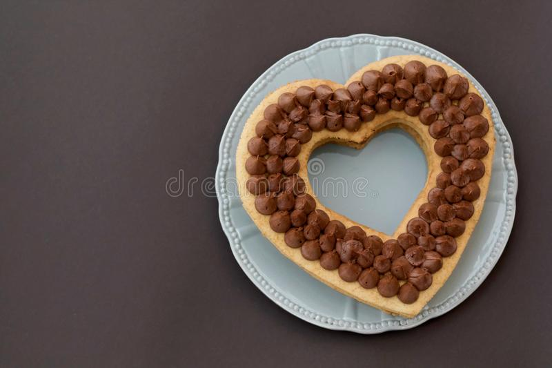 Chocolate cake in shape of heart on Valentine`s Day or Woman`s day. Place for text royalty free stock photography