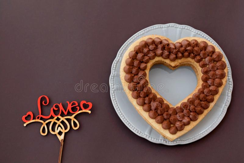 Chocolate cake in shape of heart on Valentine`s Day or Woman`s day. Place for text stock image