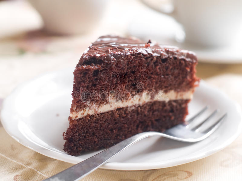 Chocolate cake. Slice with coffee, selective focus stock photography