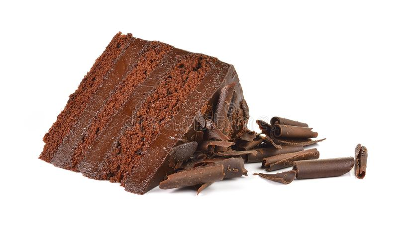 Chocolate cake slice with curl on white background. stock photo