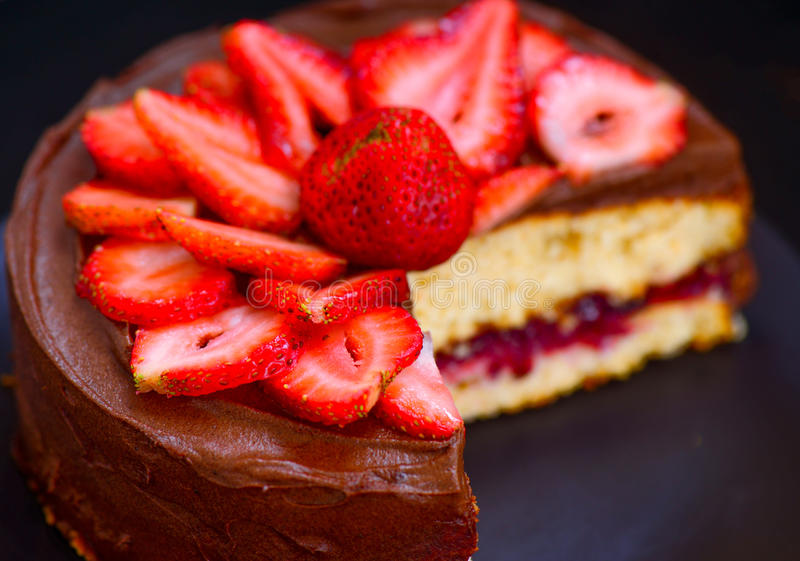 Chocolate cake with strawberries stock images