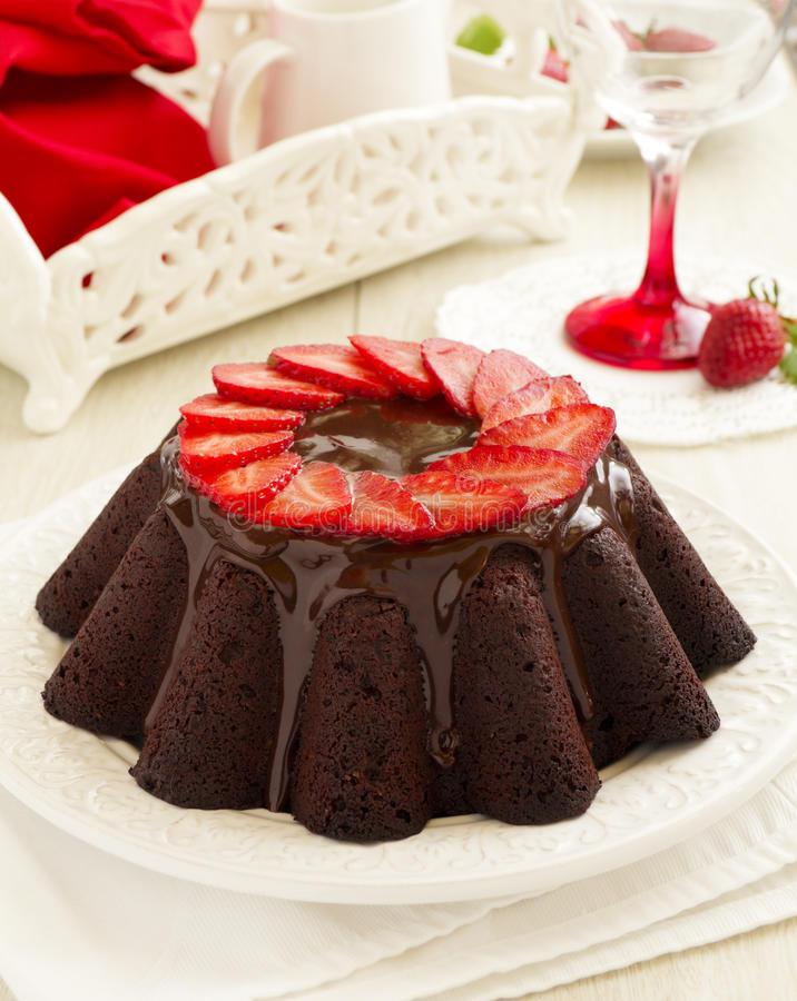 Chocolate cake with strawberries. Chocolate glaze stock photography