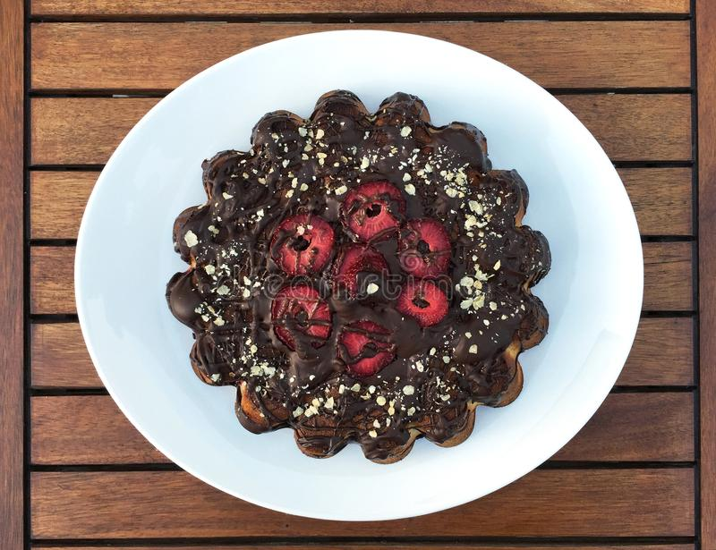 Chocolate cake with strawberries royalty free stock image